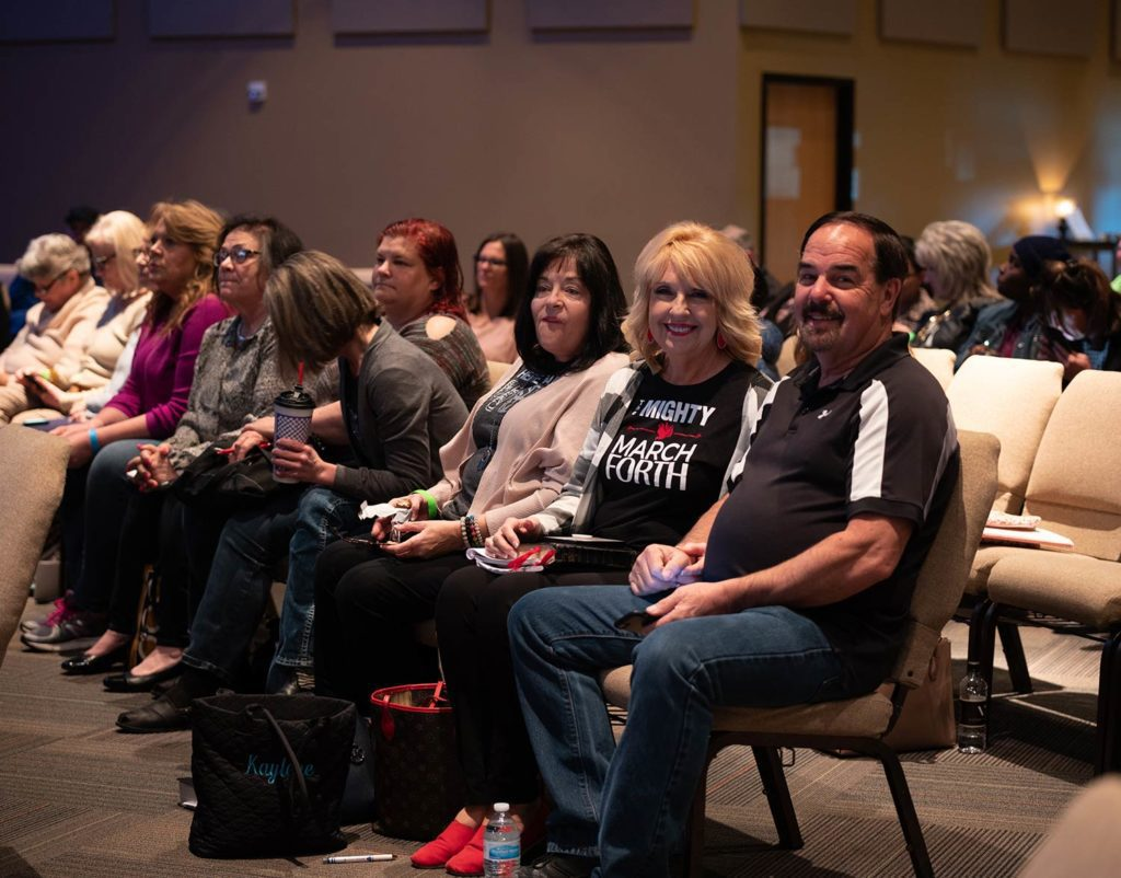 People smiling while attending a Marcus Wick Ministries event